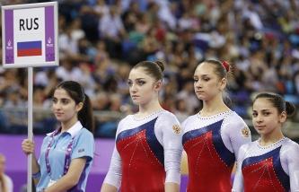 Российские гимнастки Алия Мустафина, Виктория Комова и Седа Тухталян