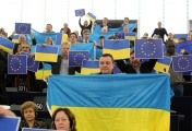 Green parties' deputies of the European Parliament hold up Ukrainian Flags and European Flags to support the demonstration in Kiev