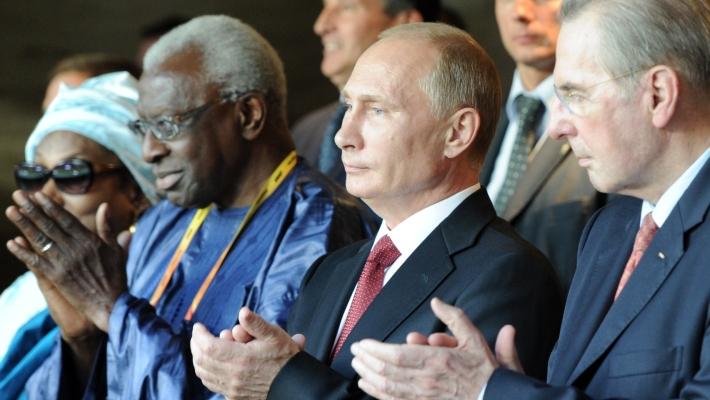 Президент МОК Жак Рогге, Владимир Путин и президент ИААФ Ламин Диак