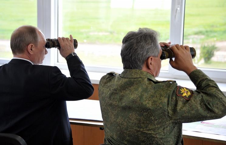 Vladimir Putin and Sergei Shoigu during military drills in July 2013
