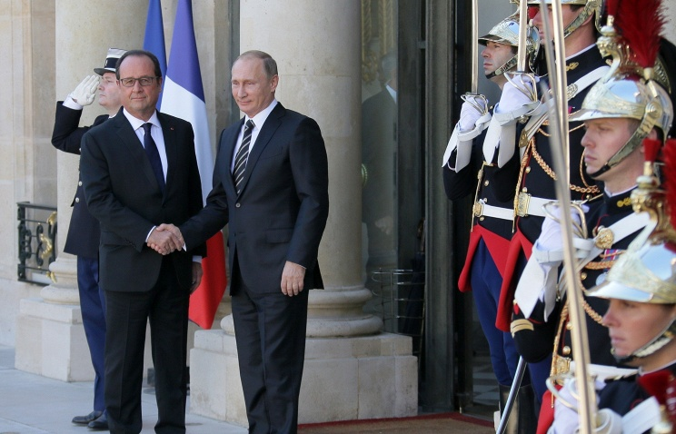 Vladimir Putin going to Paris to attend forum on climate, to meet with counterparts
